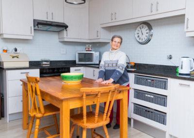 Resident in kitchen