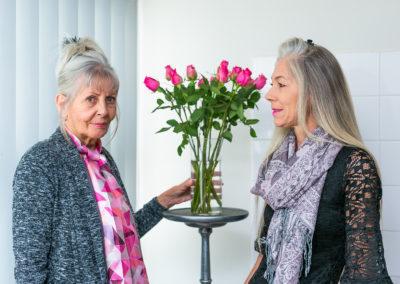 Two ladies - pink flowwers